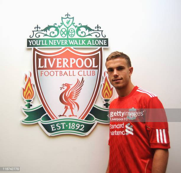 Jordan Henderson poses as he signs for Liverpool FC at Melwood Training Ground on June 8 2011 in Liverpool England