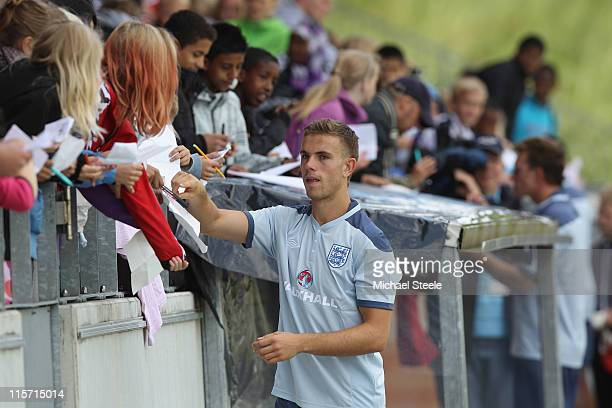 Jordan Henderson signs autographs after the England U21's training session at Montjasa Park Stadium on June 9 2011 in Fredericia Denmark