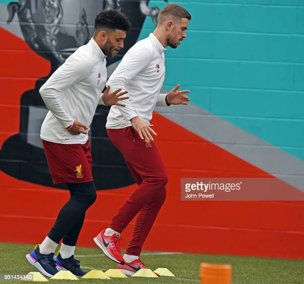 Jordan Henderson with Alex OxladeChamberlain of Liverpool during a training session at Melwood Training Ground on March 13 2018 in Liverpool England