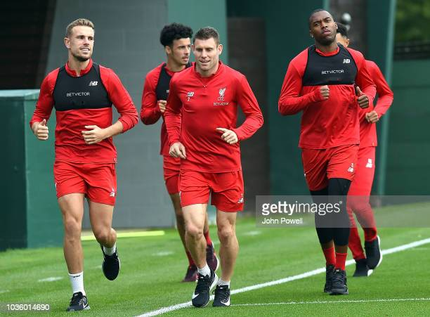 Jordan Henderson with James Milner and Daniel Sturridge of Liverpool during a training session at Melwood on September 19 2018 in Liverpool England