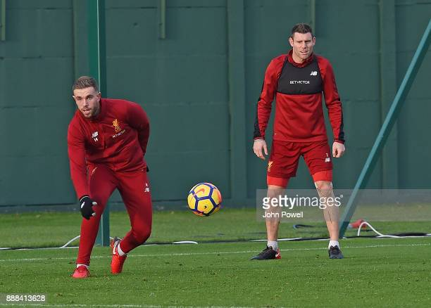 Jordan Henderson with James Milner of Liverpool during a training session at Melwood Training Ground on December 8 2017 in Liverpool England