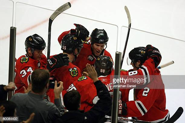 Jordan Hendry Duncan Keith Patrick Kane Ben Eager and Petri Kontiola of the Chicago Blackhawks celebrate after Kane scored a third period goal...