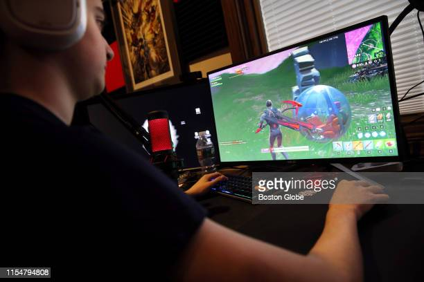Jordan Herzog aka Crimz plays Fortnite at his home in Sudbury MA on May 30 2019 Jordan is one of the world's top Fortnite players and recently...