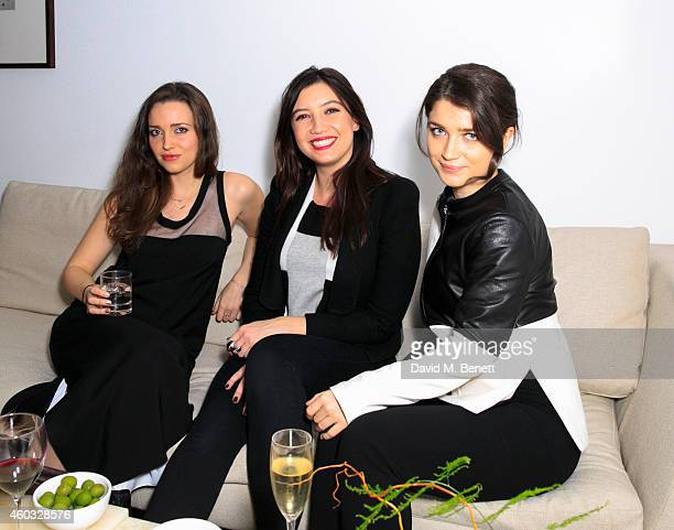Jordan Hewson Daisy Lowe and Eve Hewson attend the Edun Pre Fall Dinner at Alison Jacques Gallery on December 11 2014 in London England
