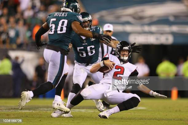 Jordan Hicks and Chris Long of the Philadelphia Eagles sack Matt Ryan of the Atlanta Falcons during the fourth quarter at Lincoln Financial Field on...