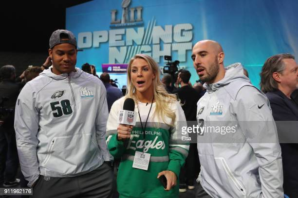 Jordan Hicks and Chris Maragos of the Philadelphia Eagles are interviewed by Julie Ertz of the USA women's national soccer team and wife of Zach Ertz...