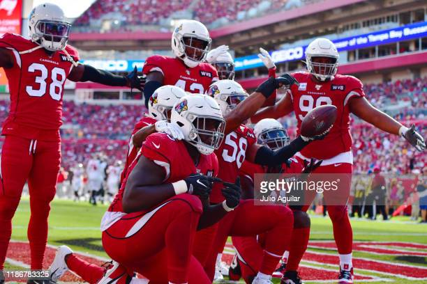 Jordan Hicks of the Arizona Cardinals celebrates with teammates after intercepting Jameis Winston of the Tampa Bay Buccaneers during the third...