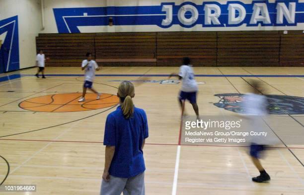 1/27/05 Jordan High women's basketball coach Adara Newidouski keeps an eye on her players during practice in Long Beach California on January 27 2005