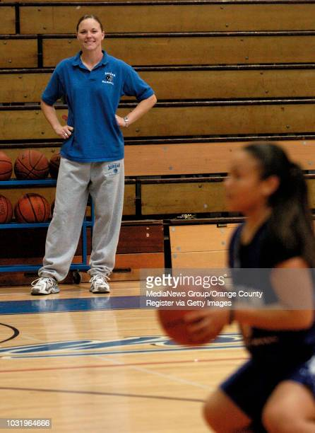 1/27/05 Jordan High women's basketball coach Adara Newidouski keeps an eye on player Gabbie Cabrera as she works on her free throws during practice...