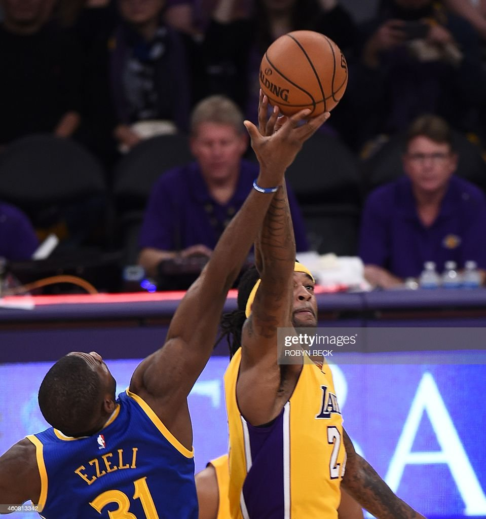 Jordan Hill (27) of the Los Angeles Lakers and Festus Ezeli (31) of the Golden State Warriors tip off at the start of their NBA game, December 23, 2014 at Staples Center in Los Angeles, California.
