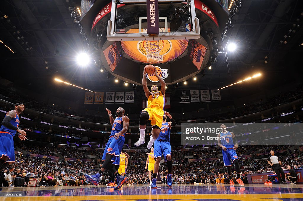 Jordan Hill #27 of the Los Angeles Lakers goes up for a shot against the New York Knicks at Staples Center on March 25, 2014 in Los Angeles, California.