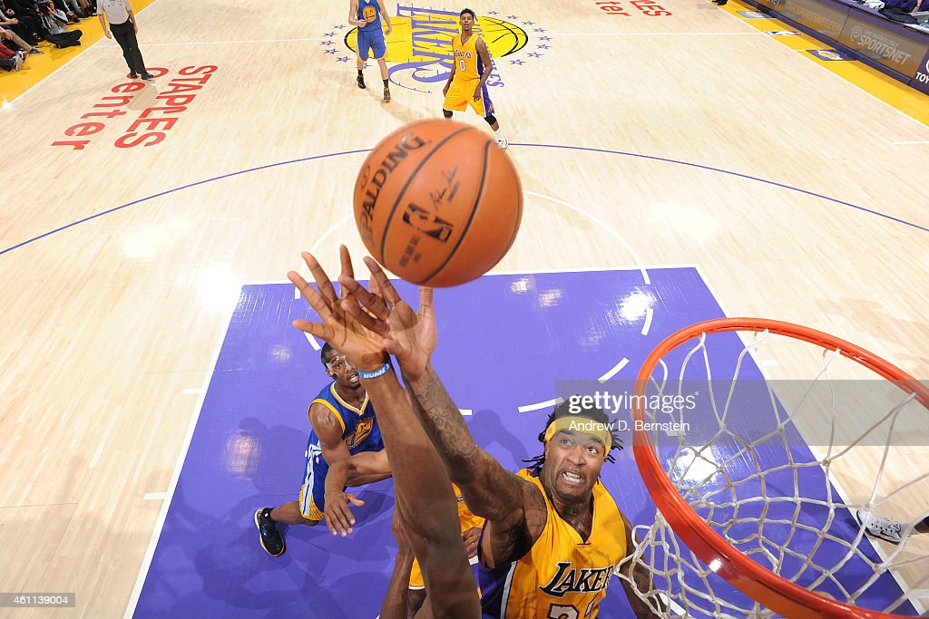 Jordan Hill #27 of the Los Angeles Lakers grabs a rebound against the Golden State Warriors on December 23, 2014 at Staples Center in Los Angeles, California.