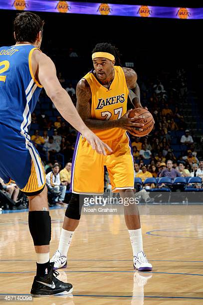 Jordan Hill of the Los Angeles Lakers handles the ball during the game against the Golden State Warriors on October 12 2014 at Citizens Business Bank...