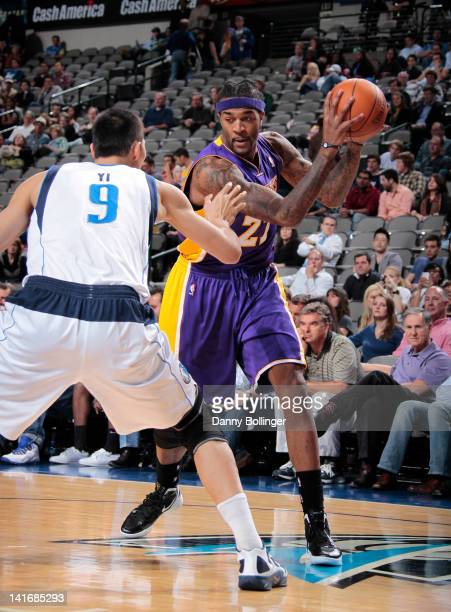 Jordan Hill of the Los Angeles Lakers looks to drive against Yi Jianlian of the Dallas Mavericks on March 21 2012 at the American Airlines Center in...
