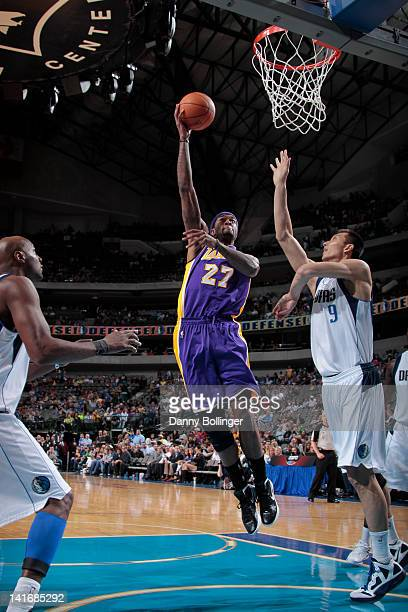 Jordan Hill of the Los Angeles Lakers puts up the hook shot against Yi Jianlian of the Dallas Mavericks on March 21 2012 at the American Airlines...