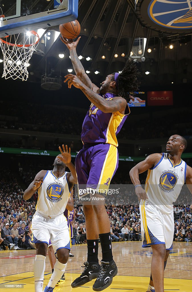 Jordan Hill #27 of the Los Angeles Lakers shoots over Draymond Green #23 of the Golden State Warriors on December 22, 2012 at Oracle Arena in Oakland, California.