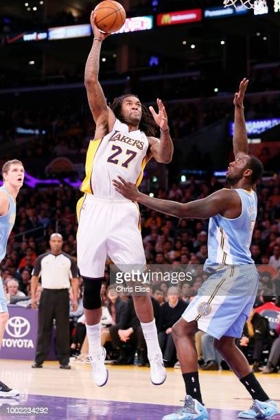 Jordan Hill of the Los Angeles Lakers shoots the ball against the Denver Nuggets on January 5 2014 at the Staples Center in Los Angeles CA USA NOTE...