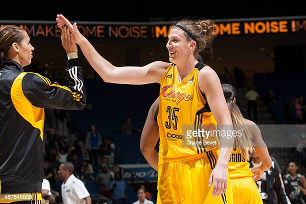 Jordan Hooper celebrates her first WNBA win with Nicole Powell of the Tulsa Shock during the WNBA game against the San Antonio Stars on May 2 2014 at...