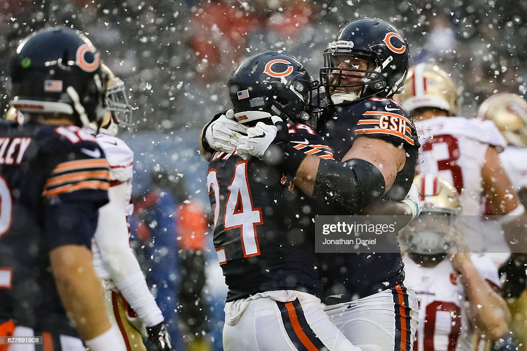 Jordan Howard #24 and Logan Paulsen #82 of the Chicago Bears react after Howard scored in the third quarter against the San Francisco 49ers at Soldier Field on December 4, 2016 in Chicago, Illinois.