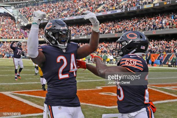 Jordan Howard and Tarik Cohen of the Chicago Bears celebrate after Howard scored a touchdown in the first quarter against the Green Bay Packers with...