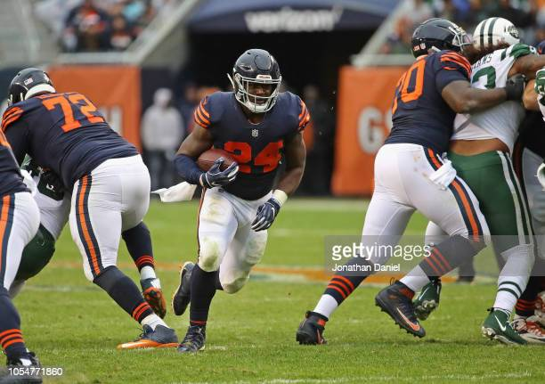Jordan Howard of the Chicago Bears breaks a 24 yard first down run against the New York Jets at Soldier Field on October 28 2018 in Chicago Illinois...