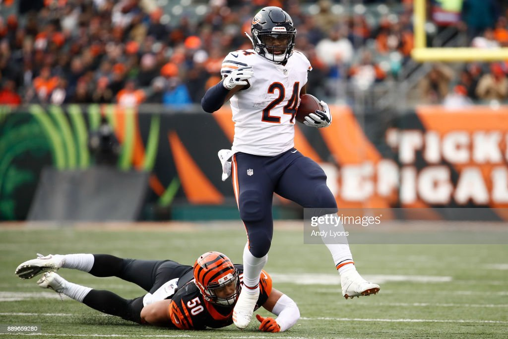 Jordan Howard #24 of the Chicago Bears breaks a tackle from Jordan Evans #50 of the Cincinnati Bengals during the second half at Paul Brown Stadium on December 10, 2017 in Cincinnati, Ohio.