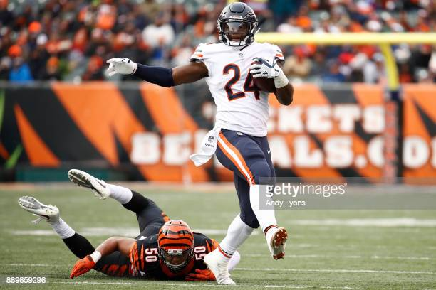Jordan Howard of the Chicago Bears breaks a tackle from Jordan Evans of the Cincinnati Bengals during the second half at Paul Brown Stadium on...