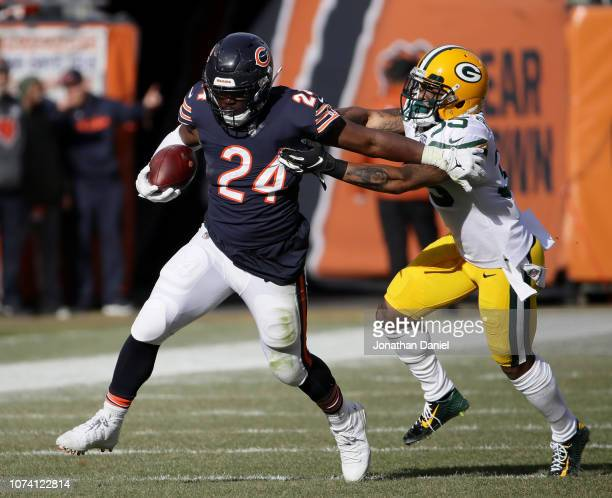 Jordan Howard of the Chicago Bears carries the football against Eddie Pleasant of the Green Bay Packers in the first quarter at Soldier Field on...