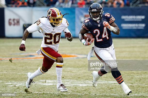 Jordan Howard of the Chicago Bears carries the football against Greg Toler of the Washington Redskins in the first quarter at Soldier Field on...