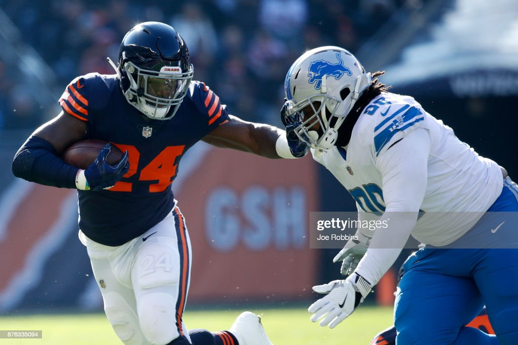 Jordan Howard #24 of the Chicago Bears carries the football against Khyri Thornton #99 of the Detroit Lions in the first quarter at Soldier Field on November 19, 2017 in Chicago, Illinois.