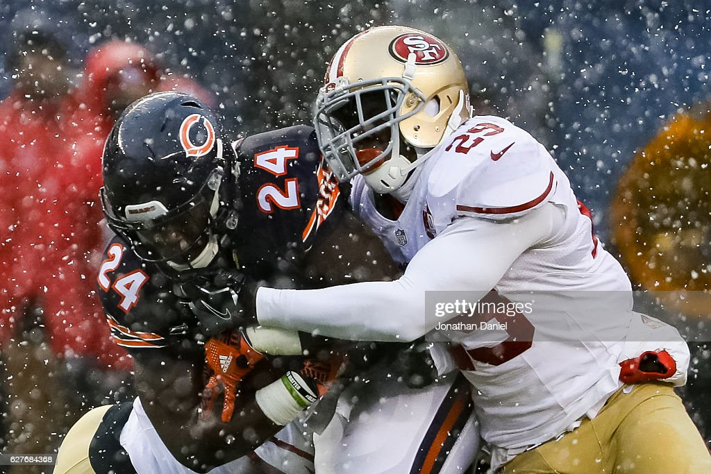 Jordan Howard #24 of the Chicago Bears carries the football against Jaquiski Tartt #29 of the San Francisco 49ers in the first quarter at Soldier Field on December 4, 2016 in Chicago, Illinois.