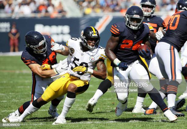 Jordan Howard of the Chicago Bears carries the football past Ryan Shazier of the Pittsburgh Steelers in the second quarter at Soldier Field on...
