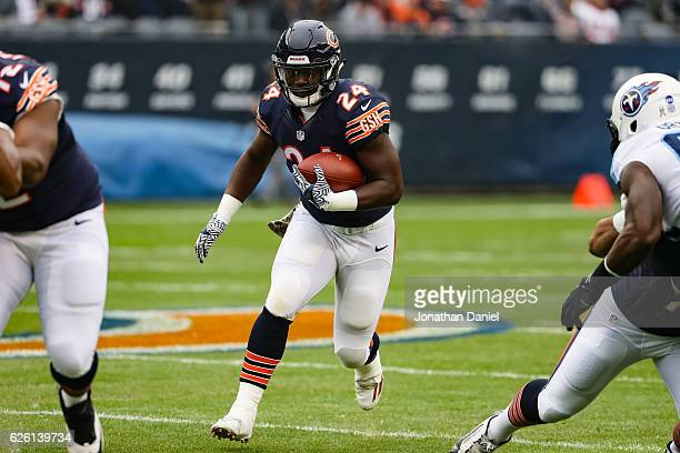 Jordan Howard of the Chicago Bears carries the football through an opening in the first quarter against the Tennessee Titans at Soldier Field on...