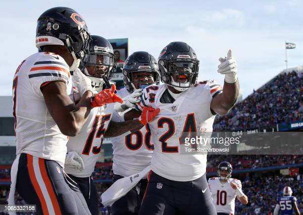 Jordan Howard of the Chicago Bears celebrates after scoring a touchdown with James Daniels and Joshua Bellamy and Anthony Miller during NFL game...