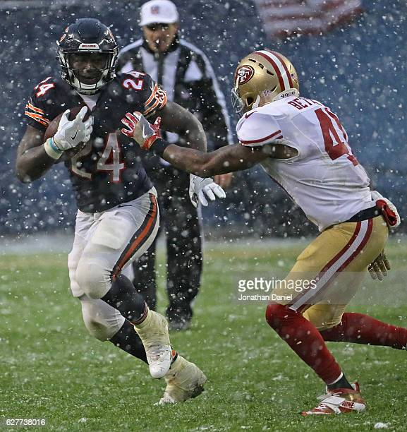 Jordan Howard of the Chicago Bears is chased by Antoine Bethea of the San Francisco 49ers at Soldier Field on December 4 2016 in Chicago Illinois The...