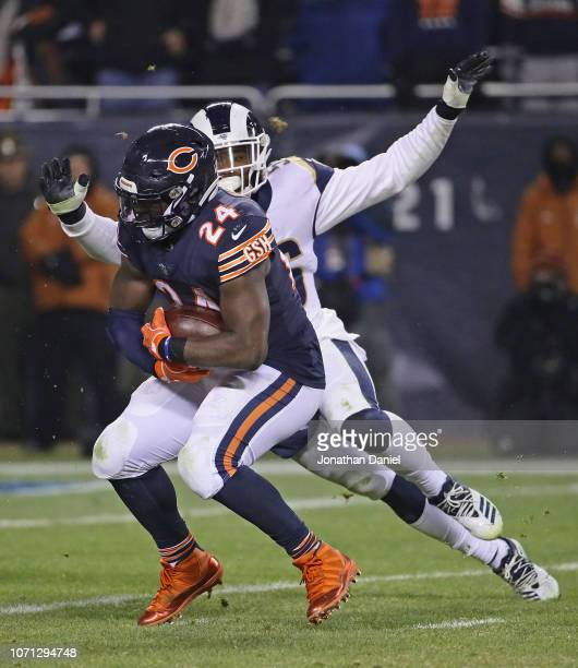 Jordan Howard of the Chicago Bears is chased by Dante Fowler of the Los Angeles Rams at Soldier Field on December 9 2018 in Chicago Illinois
