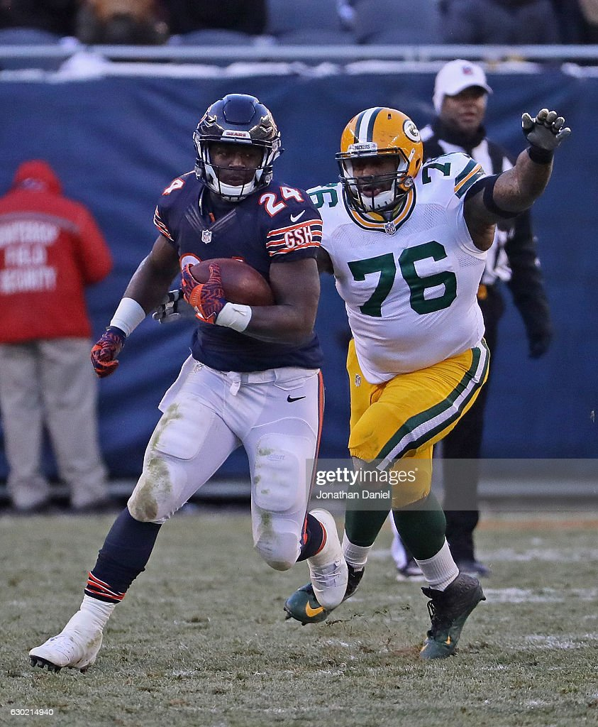 Jordan Howard #24 of the Chicago Bears is chased by Mike Daniels #76 of the Green Bay Packers at Soldier Field on December 18, 2016 in Chicago, Illinois. The Packers defeated the Bears 30-27.