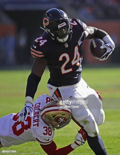 Jordan Howard of the Chicago Bears is hit by Adrian Colbert of the San Francisco 49ers at Soldier Field on December 3 2017 in Chicago Illinois The...