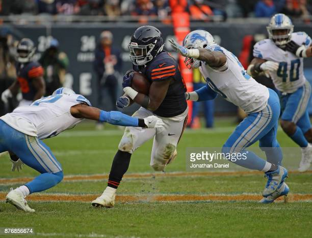 Jordan Howard of the Chicago Bears is hit by Tavon Wilson and Tahir Whitehead of the Detroit Lions at Soldier Field on November 19 2017 in Chicago...