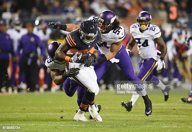 Jordan Howard of the Chicago Bears is tackled by Danielle Hunter and Eric Kendricks of the Minnesota Vikings during the first half of their game at...