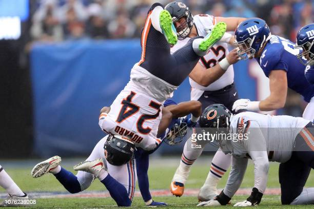 Jordan Howard of the Chicago Bears is tackled by Grant Haley of the New York Giants at MetLife Stadium on December 02 2018 in East Rutherford New...
