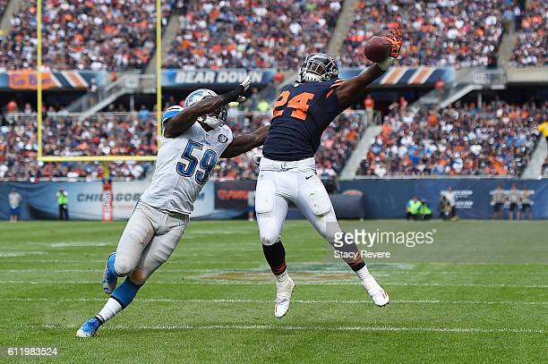 Jordan Howard of the Chicago Bears reaches for a pass in front of Tahir Whitehead of the Detroit Lions during the first half of a game at Soldier...
