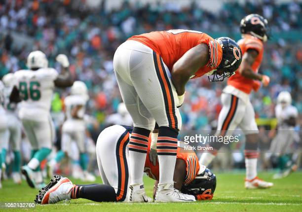 Jordan Howard of the Chicago Bears reacts after fumbling in the second quarter against the Miami Dolphins of the game at Hard Rock Stadium on October...