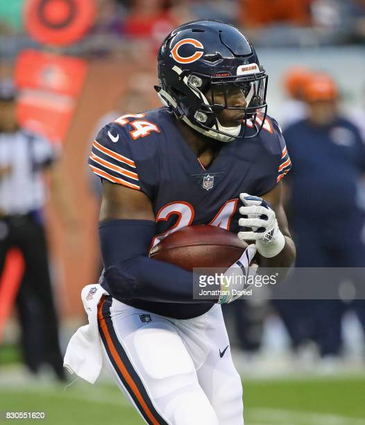 Jordan Howard of the Chicago Bears runs against the Denver Broncos during a preseason game at Soldier Field on August 10 2017 in Chicago Illinois