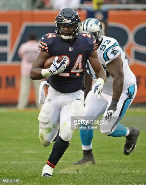 Jordan Howard of the Chicago Bears runs for a first down against the Carolina Panthers at Soldier Field on October 22 2017 in Chicago Illinois The...