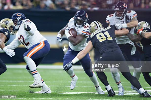 Jordan Howard of the Chicago Bears runs the ball up the middle and is hit by Trey Hendrickson of the New Orleans Saints at MercedesBenz Superdome on...