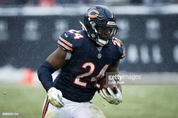 Jordan Howard of the Chicago Bears runs with the ball in the fourth quarter against the Cleveland Browns at Solider Field on December 24 2017 in...