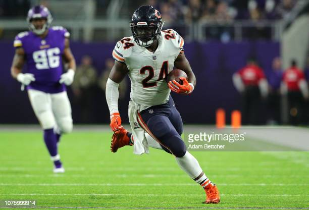 Jordan Howard of the Chicago Bears runs with the ball in the third quarter of the game against the Minnesota Vikings at US Bank Stadium on December...