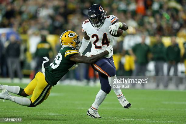 Jordan Howard of the Chicago Bears runs with the ball while being chased by Kentrell Brice of the Green Bay Packers in the fourth quarter at Lambeau...
