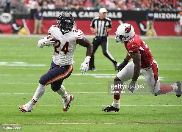 Jordan Howard of the Chicago Bears runs with the ball while being chased by Gerald Hodges of the Arizona Cardinals during the first quarter at State...